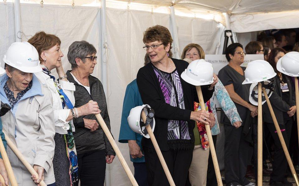 Participants prepare to break ground