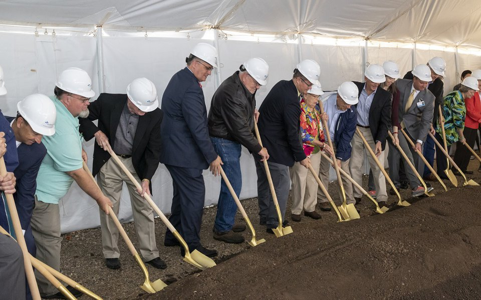 The ground breakers put their shovels into the dirt