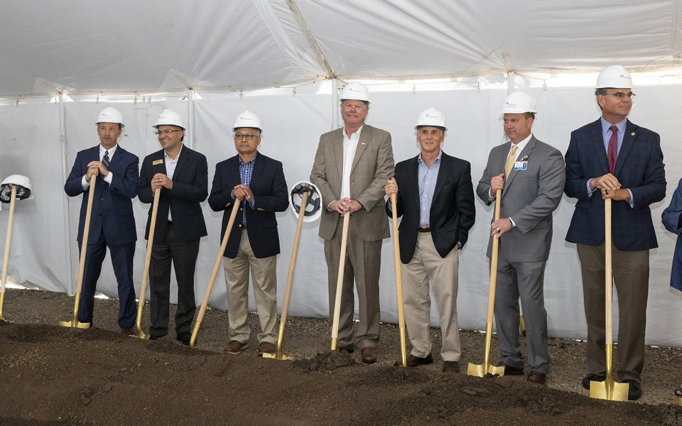 Groundbreaking participants pose with their shovels