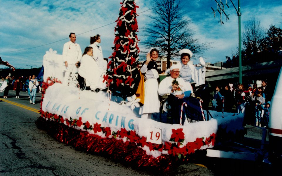 A historic photo of a Christmas parade holiday float