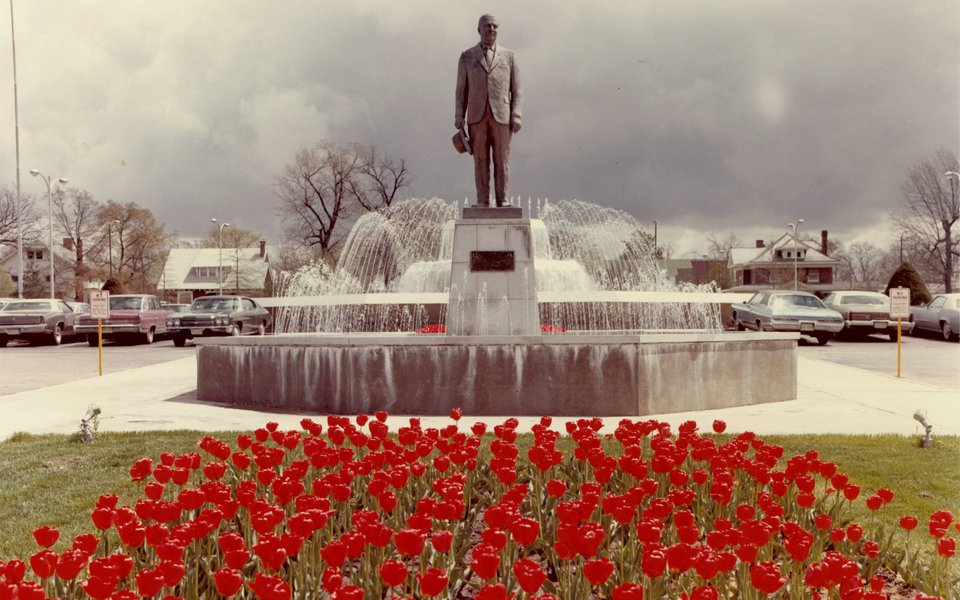 A historic photo of the Cox North fountain surrounded by red tulips