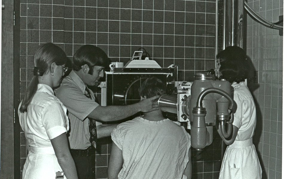 A historic photo of an eye exam at CoxHealth