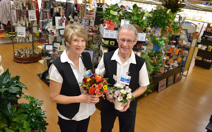 Two cox health employees holding flowers in the gift shop