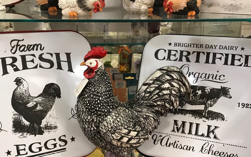 A metal rooster on display at the gift shop