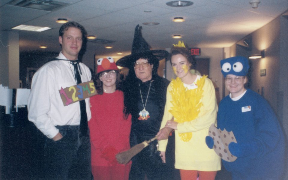 A historic photo of Neil Wortley and employees on Halloween