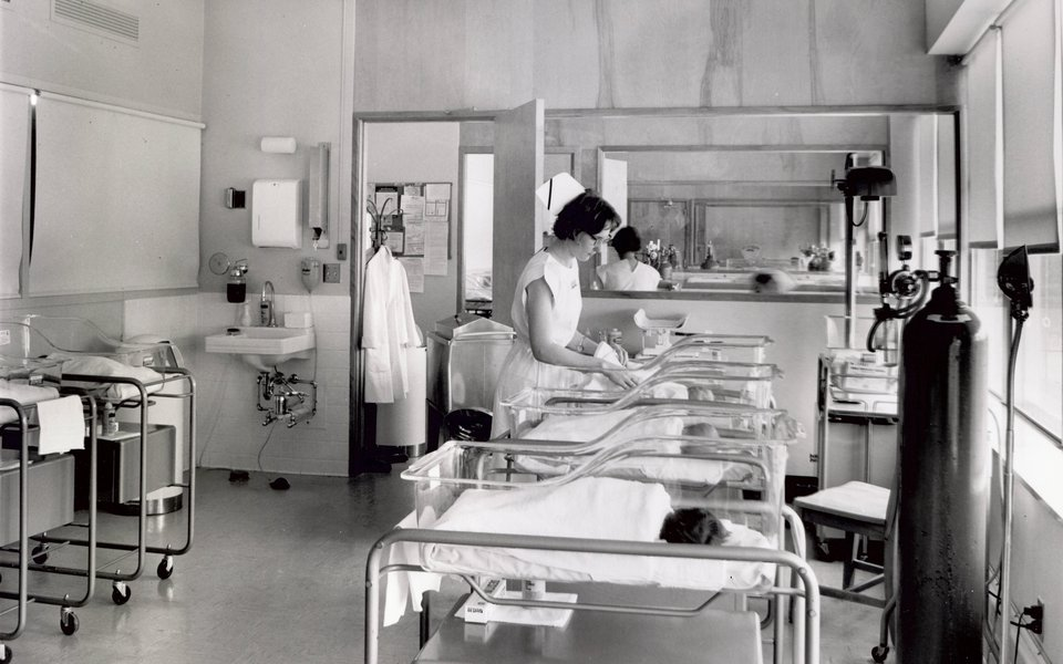 A historic photo of an infant nursery at CoxHealth