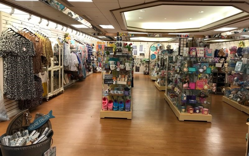 Clothing displays inside the gift shop at Cox South