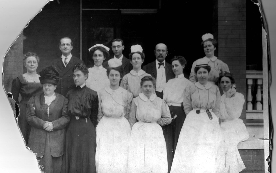 A historic photo of a group of CoxHealth nurses in the early 1900s