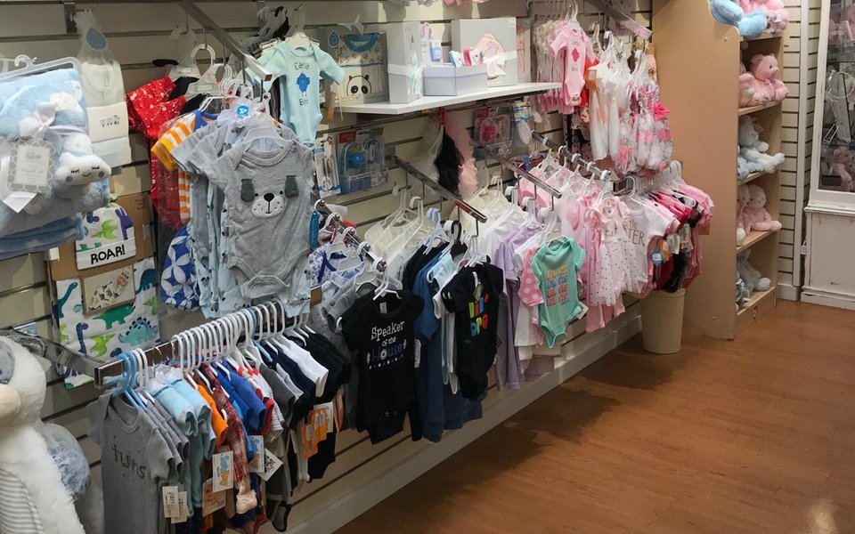 Displays with baby clothes inside the gift shop at Cox South
